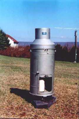 used to measure precipitation that uses a scale to weigh ...